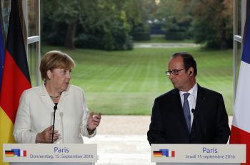 Merkelová a Hollande